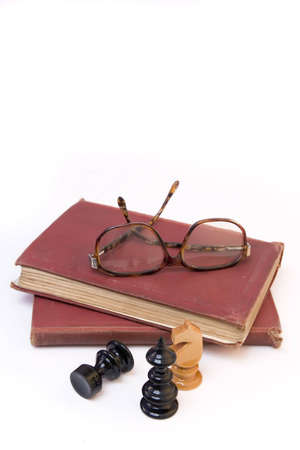 chess pieces with old book and eyeglasses Stock Photo - 3069793