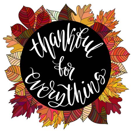 Thankful for everything hand written words in black circle on autumn leaves background.