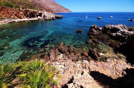 Paradise sea with azure water, beach and rocks. View from the coastline of Riserva naturale dello Zingaro. Trapani province, Sicily, Italy Stock Photo
