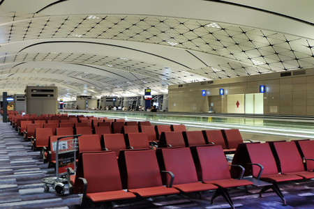 modern interiors: The red seats and modern interiors building in departure zone at Hong Kong International.