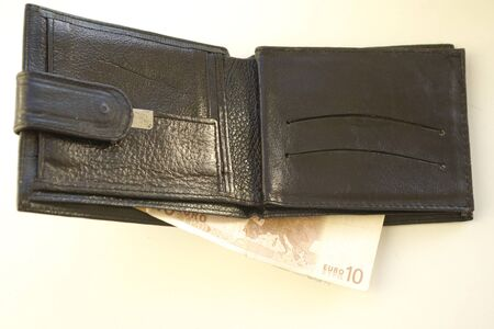 ten: Ten euro in a black wallet