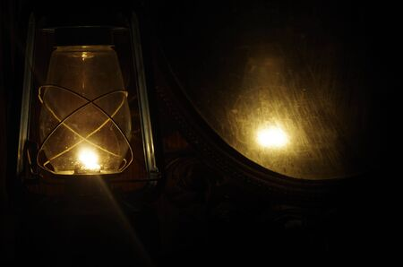 oil lamp: Oil lamp and mirror in the dark
