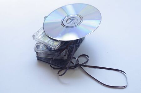 needless: CD and old audio cassettes Stock Photo