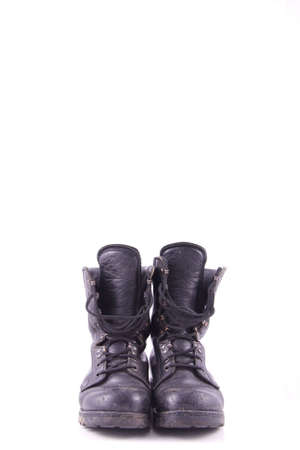 worn black army boots isolated on white background photo
