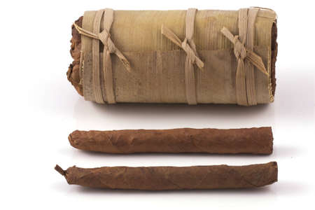 two hand rolled cigars and a cuban humidor isolated on a white background photo
