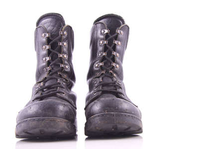 worn black amry boot isolated on white photo