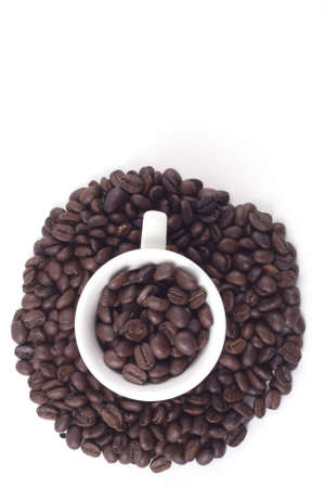 Cup of dark roasted coffee beans isolated on white Stock Photo - 8217656