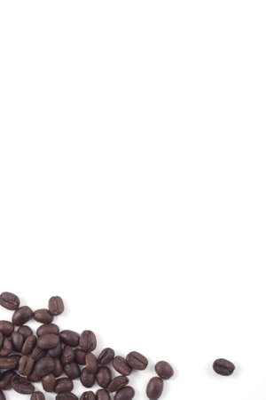 dark roasted fair trade coffee beans isolated on white Stock Photo - 8217640