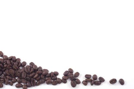 dark roasted fair trade coffee beans isolated on white Stock Photo - 8217642