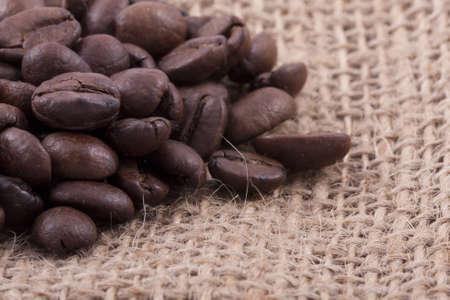 close up of dark roasted fair trade coffee beans on jute Stock Photo - 8217673