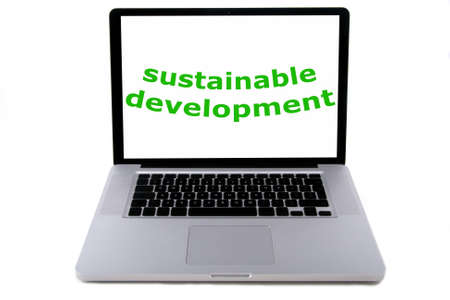 solarpower: The words sustainable development, written in green on a screen of a aluminium design laptop. belonging to the serie of people, planet, profit. Isolated on white. Stock Photo