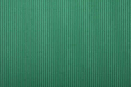 Green colored cardboard background paper photo