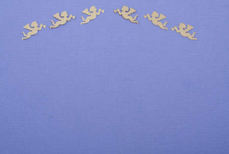Golden christmas angels on deep purple colored paper  photo