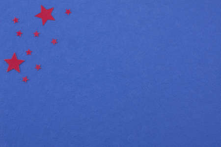 a diversity of red colored stars on deep blue colored paper Stock Photo - 8368370