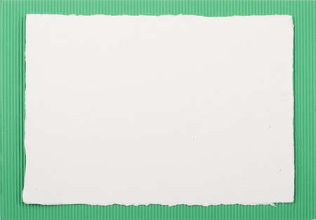 colored cardboard background with handmade white paper frame on top Stock Photo - 8368368