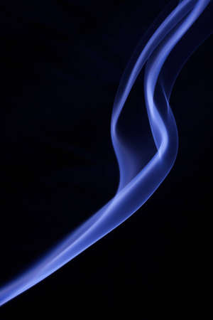 Close up of white and blue colored silky smoke isolated on a black background. Stock Photo - 8572987
