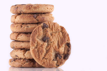 home baked: Pile of chocolate chip cookies, every cookie comes with a lot of chocolate chips, fresh baked just out of the oven isolated on white with copyspace Stock Photo