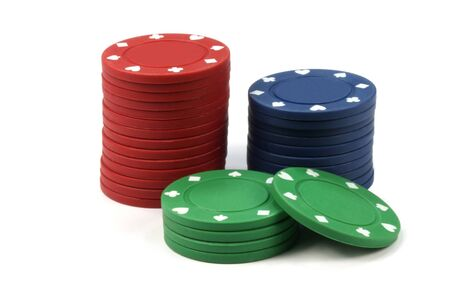 Stacked poker casino chips isolated on white background photo