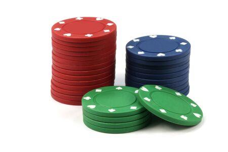 gamble: Stacked poker casino chips isolated on white background Stock Photo