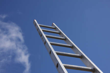 striving: Bright silver ladder against a blue sky