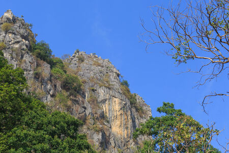 steep cliffs: Steep Cliffs of Khao Yoi Cave in Phetchaburi, Thailand Stock Photo