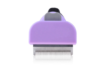 tine: Clipper comb for pet grooming close up isolated on white background