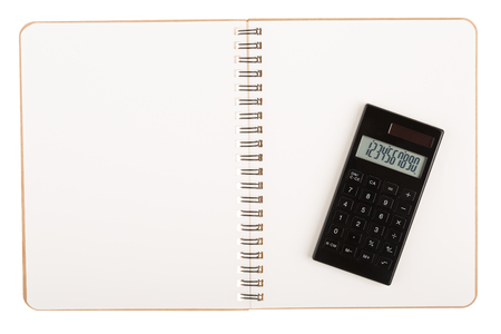 Calculator on book with spiral wire open blank two pages isolated on white background