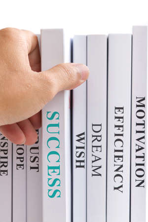 Book of success was pulled to locate in front of other books, all books contain keyword for business  Success book has a different color form the others  Suitable for business concepts Stock Photo - 27930938
