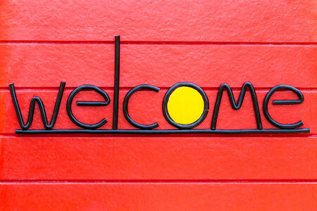 welcome sign: Welcome Sign on Red Wood Wall Stock Photo