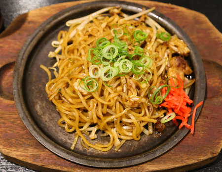 yakisoba: Yakisoba on Hot Plate with Onion and Carrot Stock Photo