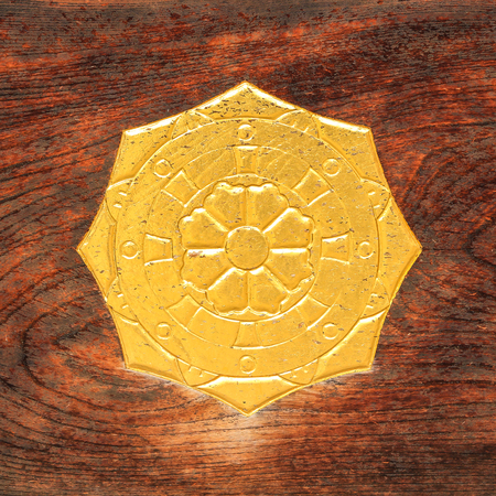 octagon: Ancient Golden Octagon Symbol of Helm and Flower on Wood
