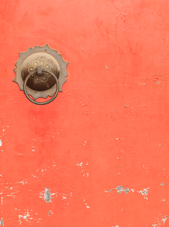 red door: Couple of Antique Brass Ring Pull Handles on Red Door