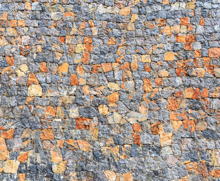 hardscape: Irregularly Shapes of Real Stone Wall with Mixed Colors Background Stock Photo