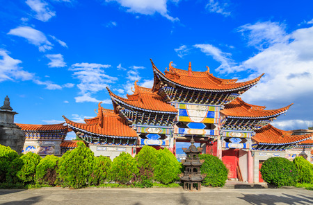 rooftile: Colorful Arched Entrance of Chinese Temple under Blue Sky in Dali, Yunnan China. Stock Photo