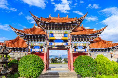 Colorful Arched Entrance of Chinese Temple under Blue Sky in Dali, Yunnan China. Stock Photo
