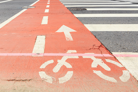 zebra crossing: Orange Bicycle lane and Zebra crossing Across a Road in Downtown, Korea