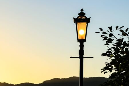 sillhouette: A classic style of lantern with sunset background sillhouette Stock Photo