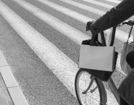 zebra crossing: Zebra crossing with bicycle moving on foreground (black & white)