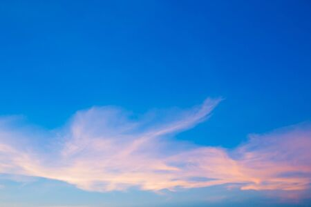 Abstract fantasy colorful sky and blurred moving clouds on blue background