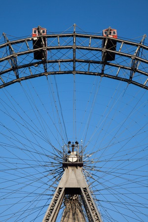 prater: Ferris wheel with red cabines in Prater park, Vienna