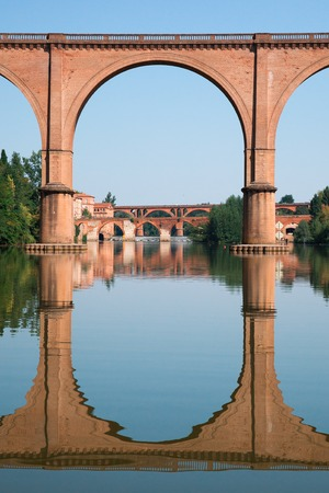 bridge over water: Bridge in Albi and its reflection in France