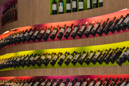 saint emilion: Bottles of wine in the store, city Saint Emilion in France Editorial