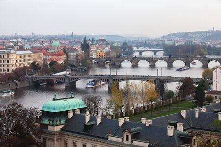 vltava: View of Prague, the bridges over the Vltava. Tourists ride on the Vltava river on boats.