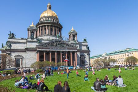 sobor: SAINT PETERSBURG RUSSIA MAY September 2015: People relax on the grass in front of St. Isaac39s Cathedral in St. Petersburg. Saint Isaac39s Cathedral or Isaakievskiy Sobor is the largest Russian Orthodox cathedral
