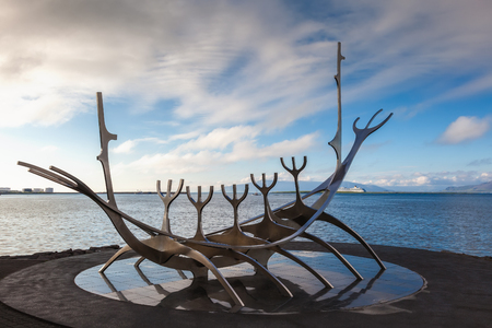 voyager: REYKJAVIK, ICELAND -   JUNE 28, 2014: Sun Voyager monument  is located by the sea in the center of Reykjavik,  designed by Jon Gunnar Arnason Editorial