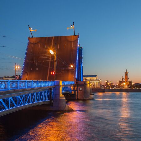 nights: White Nights in St. Petersburg, opened the Palace bridge, a view of the Spit of Vasilyevsky Island Stock Photo