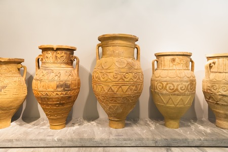 civilization: CRETE, GREECE - JULY 26, 2015: Ceramic vessels in Heraklion Archaeological Museum, it is contains the most notable and complete collection of artifacts of the Minoan civilization of Crete Editorial