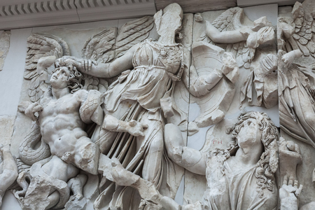 frieze: BERLIN, GERMANY - MARCH 06, 2013: Detail of the frieze of the Pergamon Altar in the Pergamon Museum. Altar was built in the 2nd century in the ancient Greek city of Pergamon in Asia Minor Editorial