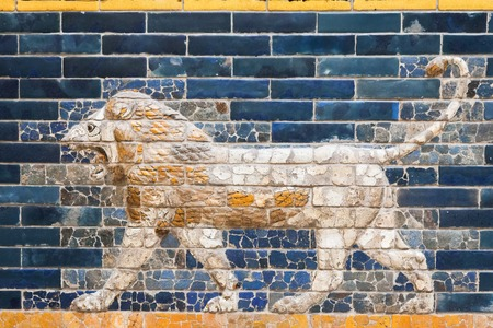 ishtar: BERLIN, GERMANY - MARCH 06, 2013: One of the lions from the Ishtar Gate of Babilon in the Pergamon Museum.  Gate was constructed in about 575 BC