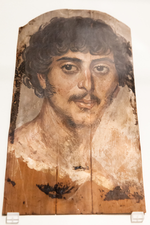 naturalistic: BERLIN, GERMANY - MARCH 05, 2013: Fayum portrait in Altes Museum. Fayum mummy portraits is a type of naturalistic painted portraits on wooden boards attached to mummies from the Coptic period on time of the Roman occupation of Egypt